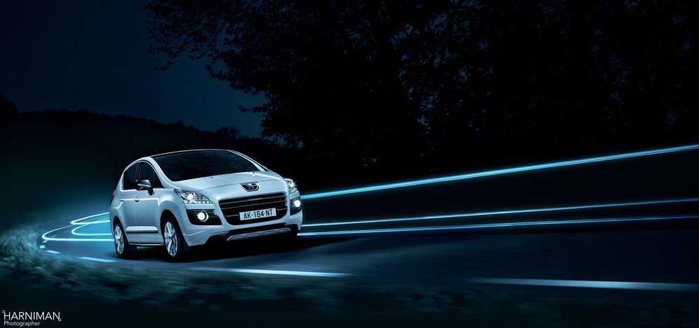 Night shots of the Peugeot diesel hybrid on the road outside Paris