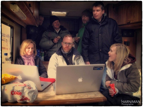 Team Mitsubishi review the captures in the welcome shelter of the RV!