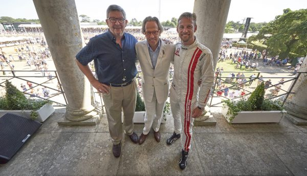 The Duke of Richmond, Jenson Button & Ross Brawn on the balcony at Goodwood House FoS 2018